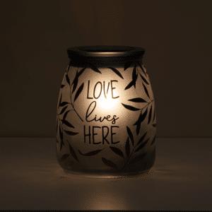 love lives here scentsy warmer in dark